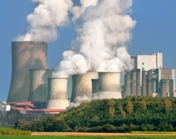 Heavily CO2 emitting coal-fired power stations like these are likely to supply the electricity to use to boil your kettle. And like your kettle, those power stations produce steam, which are the clouds shown here, not CO2 or smoke. Credit: Imperial College.