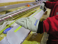 A 10 cm diameter ice core from Antarctica, drilled down to a depth of 2,250 m, which is more than 150,000 years old. The core is cleaned, measured, and catalogued after drilling. Image: Hans Oerter, Alfred Wegener Institute