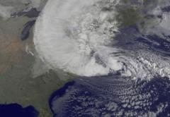 NOAA's GOES-13 satellite captured this visible image of Hurricane Sandy battering the U.S. East coast on Monday, Oct. 29 at 9:10 am EDT. Sandy's center was about 310 miles south-southeast of New York City. Tropical Storm force winds are about 1,000 miles in diameter, and are set to intensify in the 21st century.  Credit: NASA GOES Project