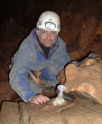 University of Oxford's Anton Vaks explores a cave, where he could find stalactites and stalagmites that reveal when the soil above was permafrost. Credit: University of Oxford