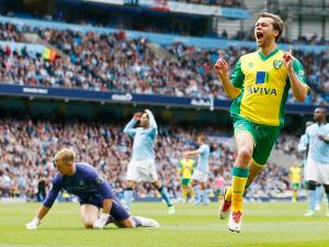Last season Norwich pulled off a seemingly even more unlikely result against Manchester City, beating them 3-2 in Manchester, with Jonny Howson getting the winner. Image credit Grant Statiall via Flickr Creative Commons license.